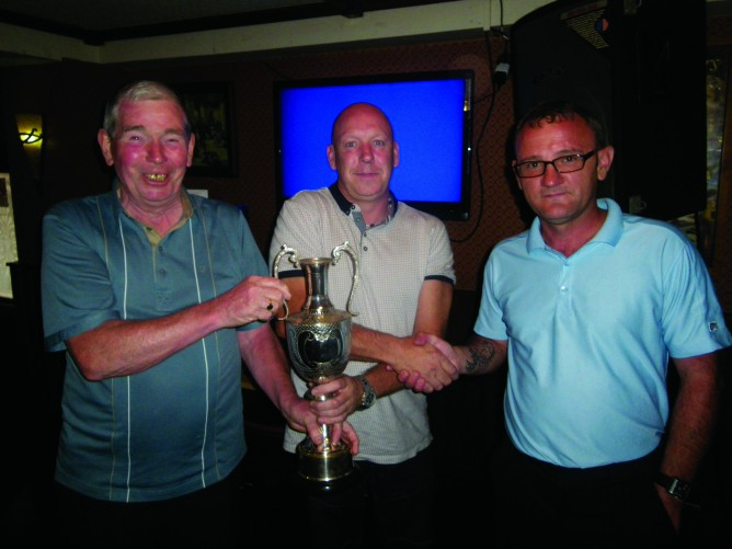 Eddie McAteer President and the Captain Joe Craig right presents the Dan Rooney Cup to Chris McCrory 668x501 Dan Rooney Cup 2014